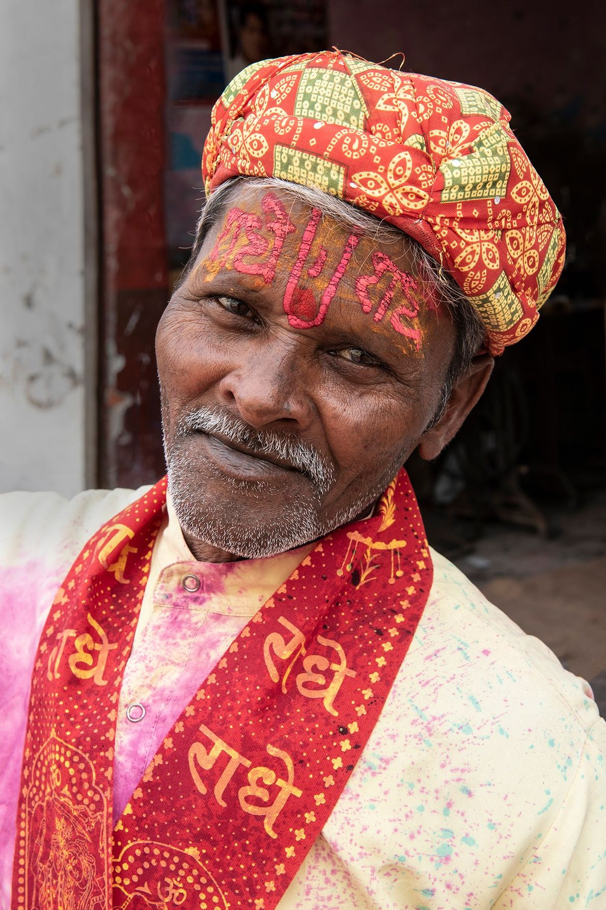 A shopkeeper at Nandgaon wears a warm smile as he welcomes people to his shop, which ...