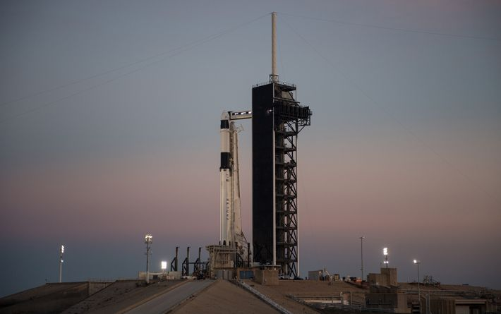 The SpaceX Falcon 9 rocket carrying the Crew Dragon spacecraft stands ready for launch from Kennedy ...