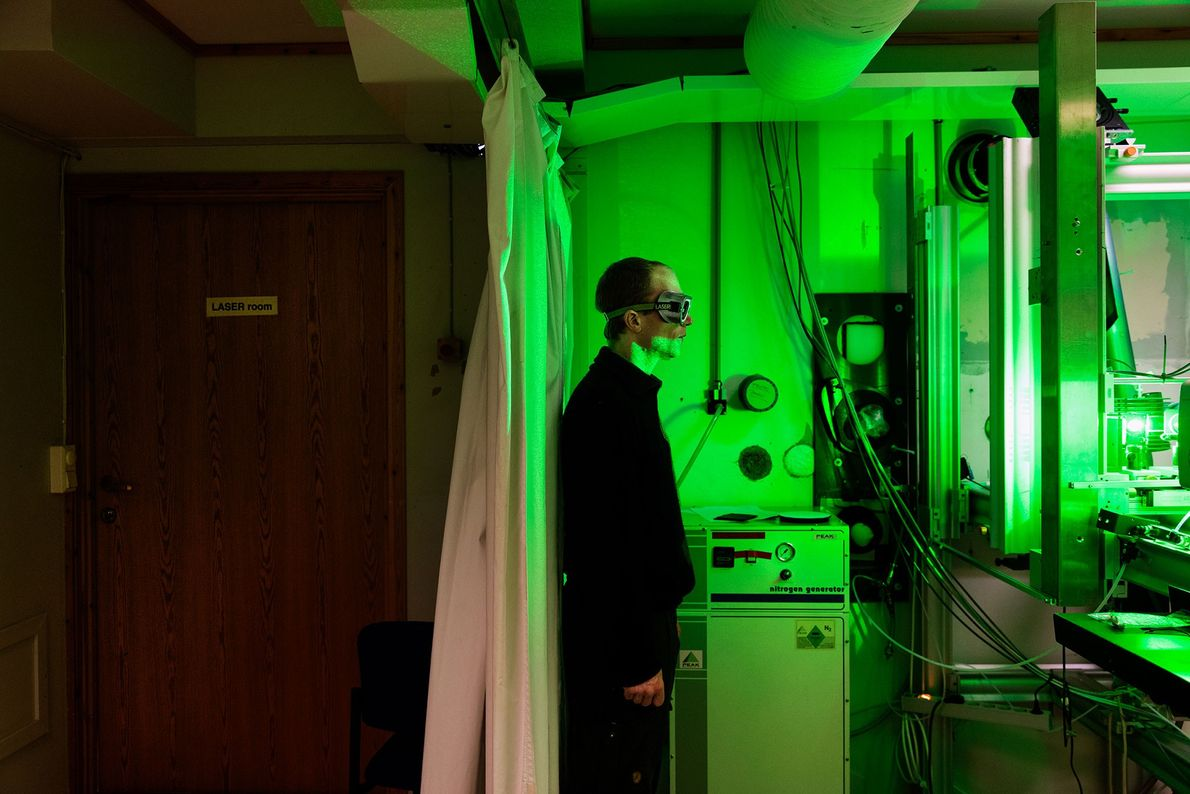 Inside the observatory at the French-German station, engineer René Bürgi operates a laser beam used to ...