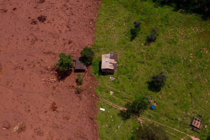An aerial view of an area affected by a mudslide after the dam's collapse.