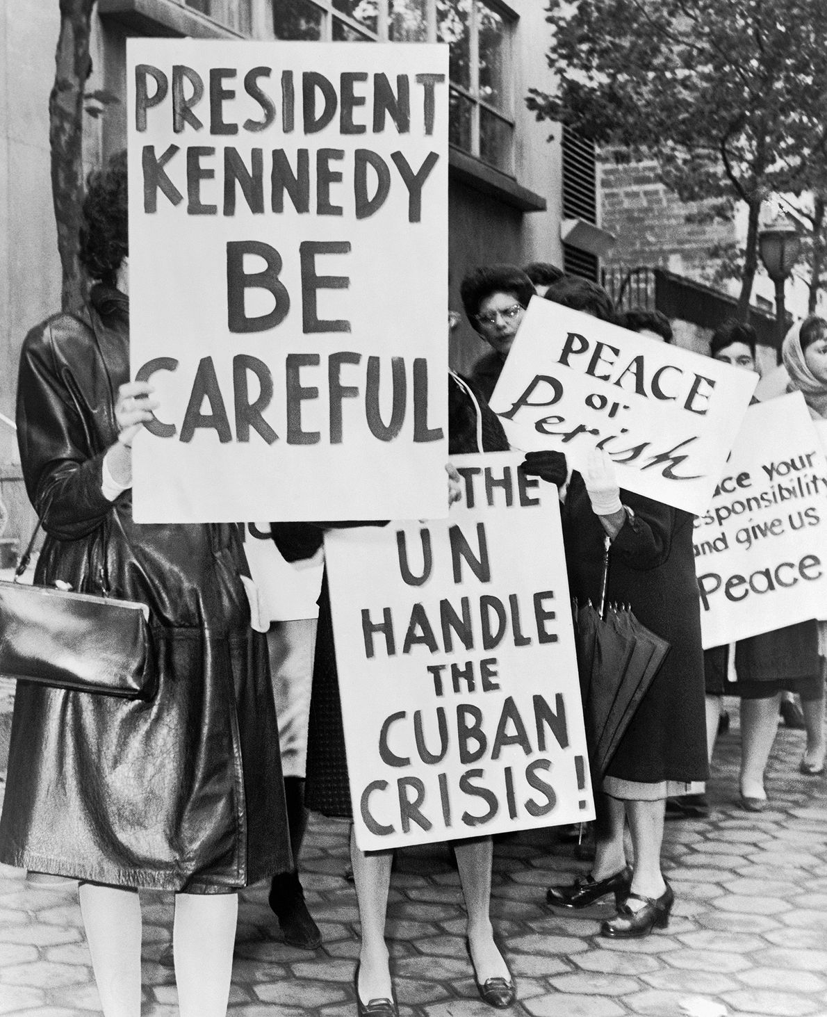 A group of women from Women Strike for Peace holding placards relating to the Cuban missile ...