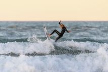 New Zealand surfing champion Ava Henderson hits the water in Christchurch on April 28, the first ...