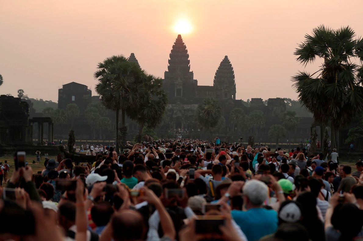 The sun rises over the central stupa of Angkor Wat temple in Siem Reap. During the ...