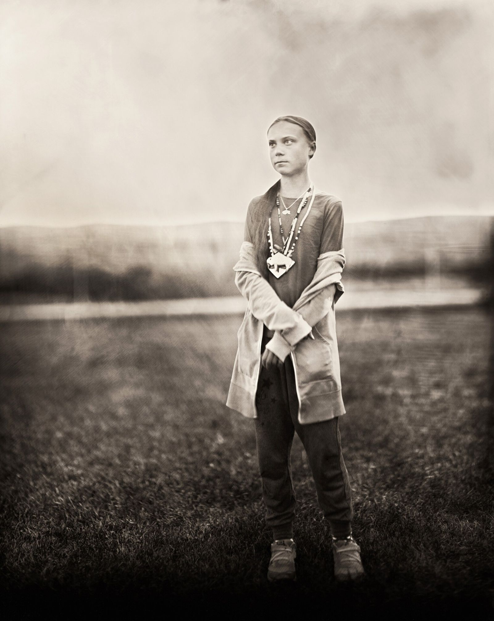 """Thunberg poses for a photo, """"Standing For Us All."""""""