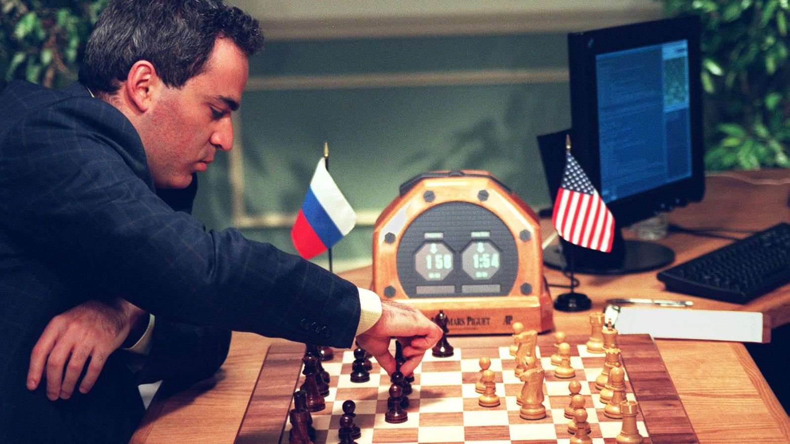 World Chess Champion Garry Kasparov makes a move in New York during his fourth game against ...