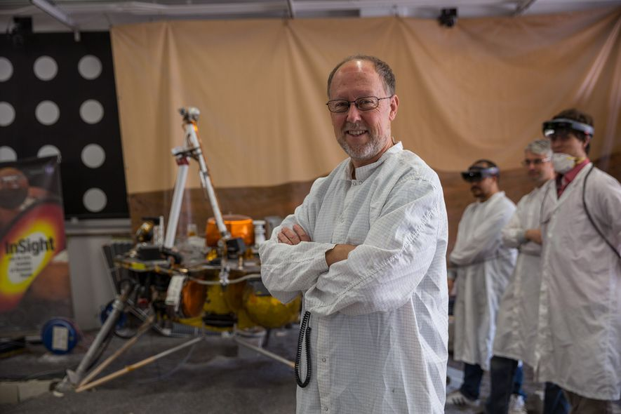Bruce Banerdt, principal investigator on the InSight lander, stands near a replica of InSight used to ...