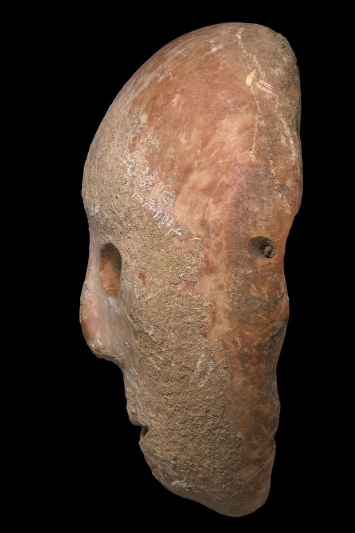 Holes drilled around the circumference of the mask lead some researchers to suggest that it was ...
