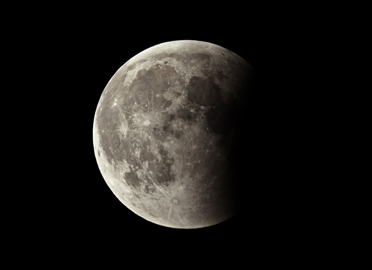 During a lunar eclipse, darkness gradually creeps across the face of the moon.