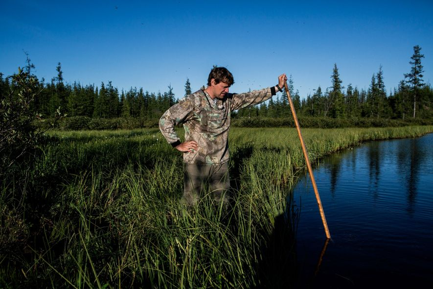 Nikita Zimov creates methane bubbles in a lake believed to be expanding due to thawing ground.