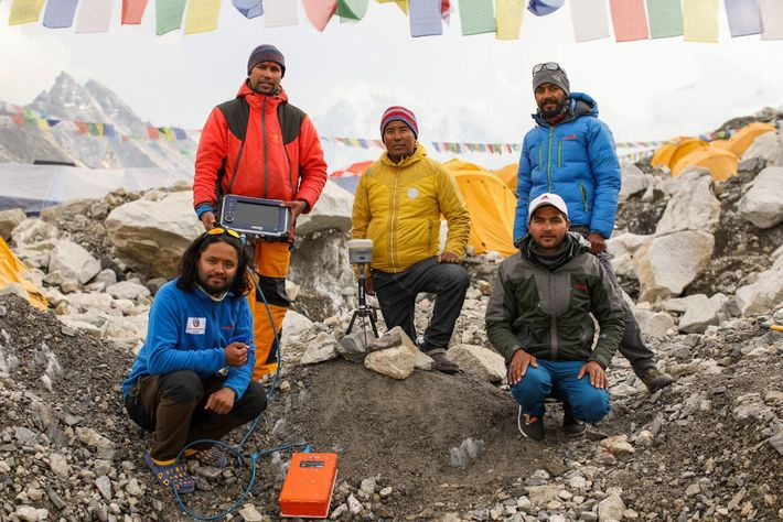 Nepal's Chief Survey Officer Khimlal Gautam (left, standing) poses with his team at Everest base camp, ...
