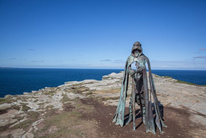 A statue inspired by the King Arthur legend greets visitors at the historic site of Tintagel ...