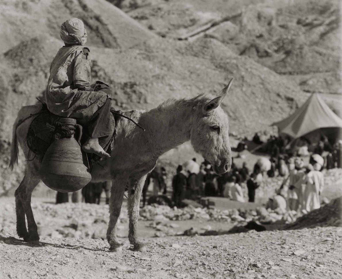 A young local delivers water by donkey to the tomb's labourers and armed guard. Then as ...