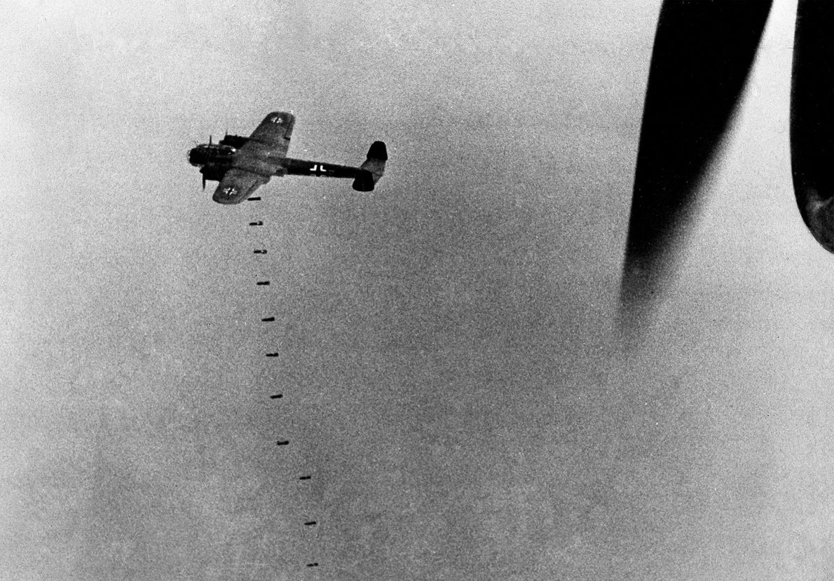 A German plane drops more than a ton of bombs over Great Britain during an attack ...