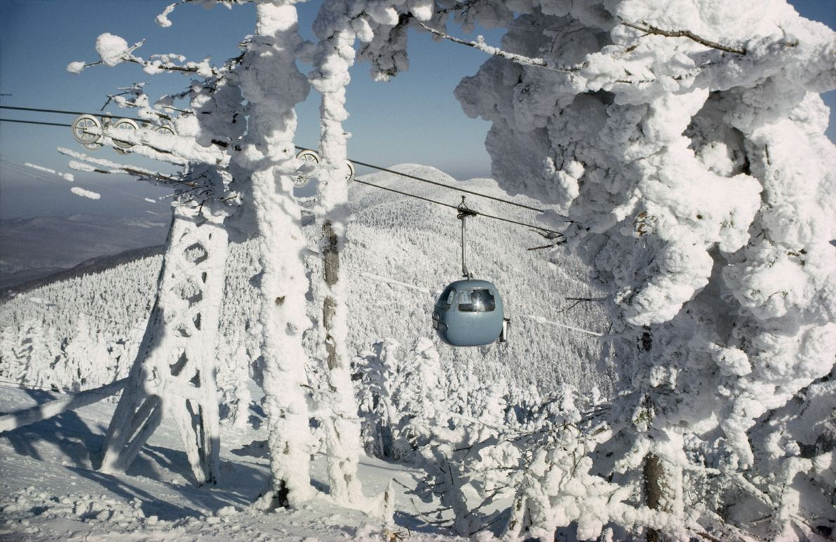 A gondola carries skiers to the top of Lincoln Peak in Green Mountain National Forest, Vermont. …
