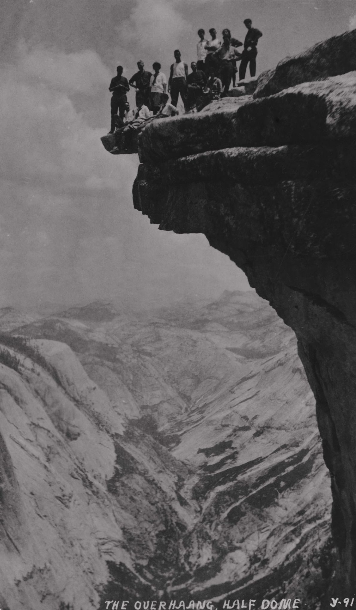 Giant chunks of rock have been falling from Half Dome. Here, in 1919, a group stands ...