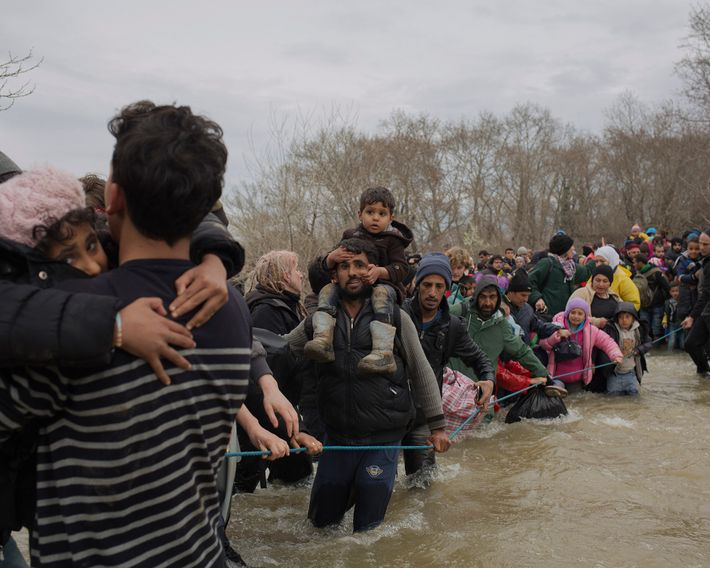 Hearing of a break in the border, families hike out of the Idomeni camp and ford ...