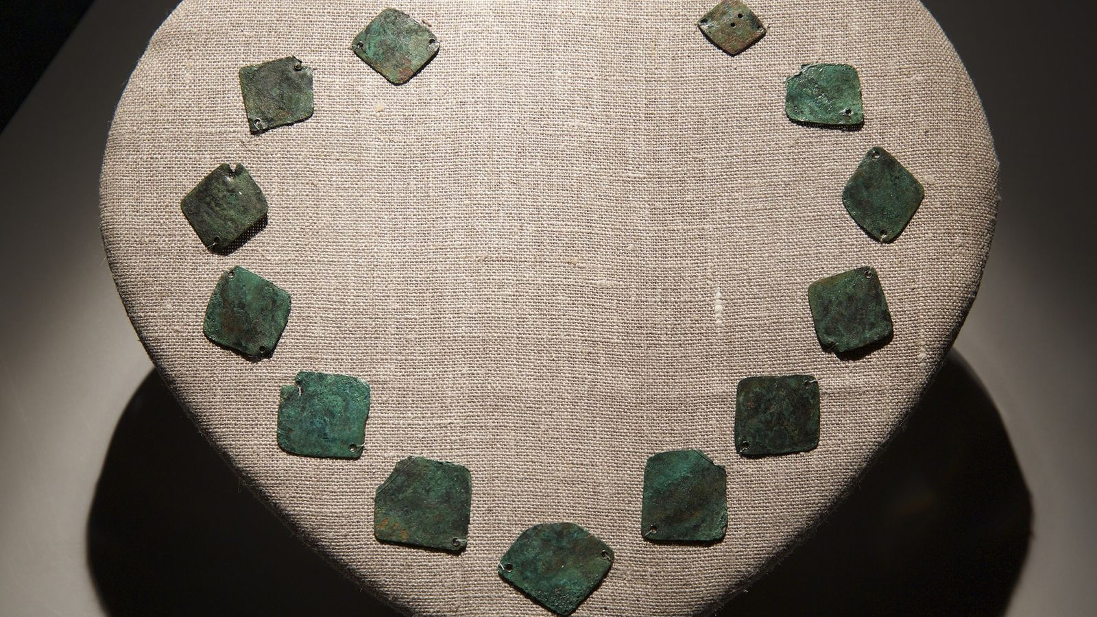 Copper plates made in Europe were once tied together into a necklace for Native Americans. The ...