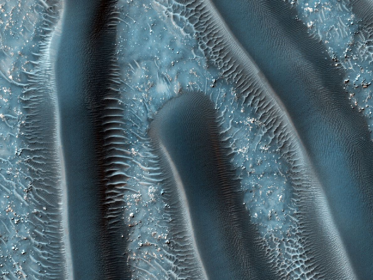 Ridges running the lengths of Martian sand dunes give the illusion of large, many-legged millipedes. Sand …