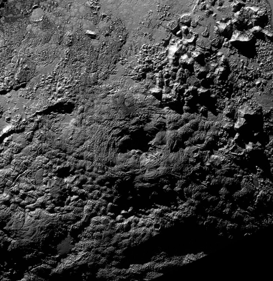 One of the potential ice volcanoes, Wright Mons, is about 100 miles (160 kilometers) wide and ...