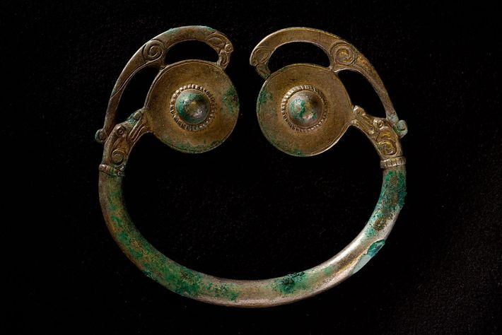 All symmetry and curving lines, the hoard's sole penannular brooch was crafted in Scotland or Ireland ...