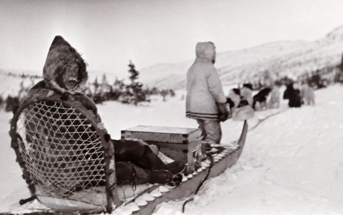 Doctor Seymour Armstrong travels by sled to answer a sick call in Labrador, Canada. The photo ...