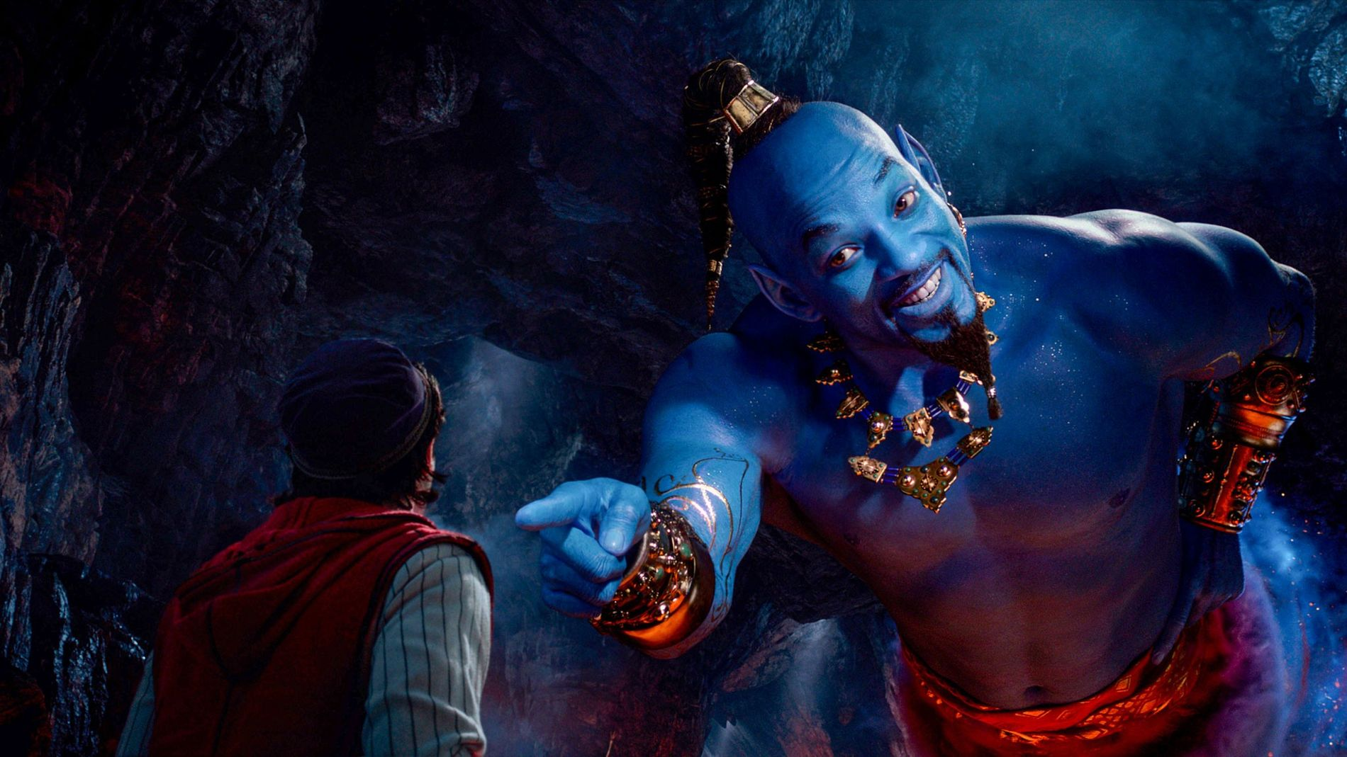 A still from the live-action version of Aladdin, in which actor Will Smith plays the genie ...
