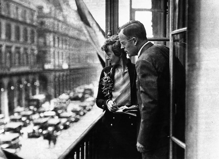 Amelia Earhart with her husband, George Palmer Putnam, on the balcony of a hotel in Paris.