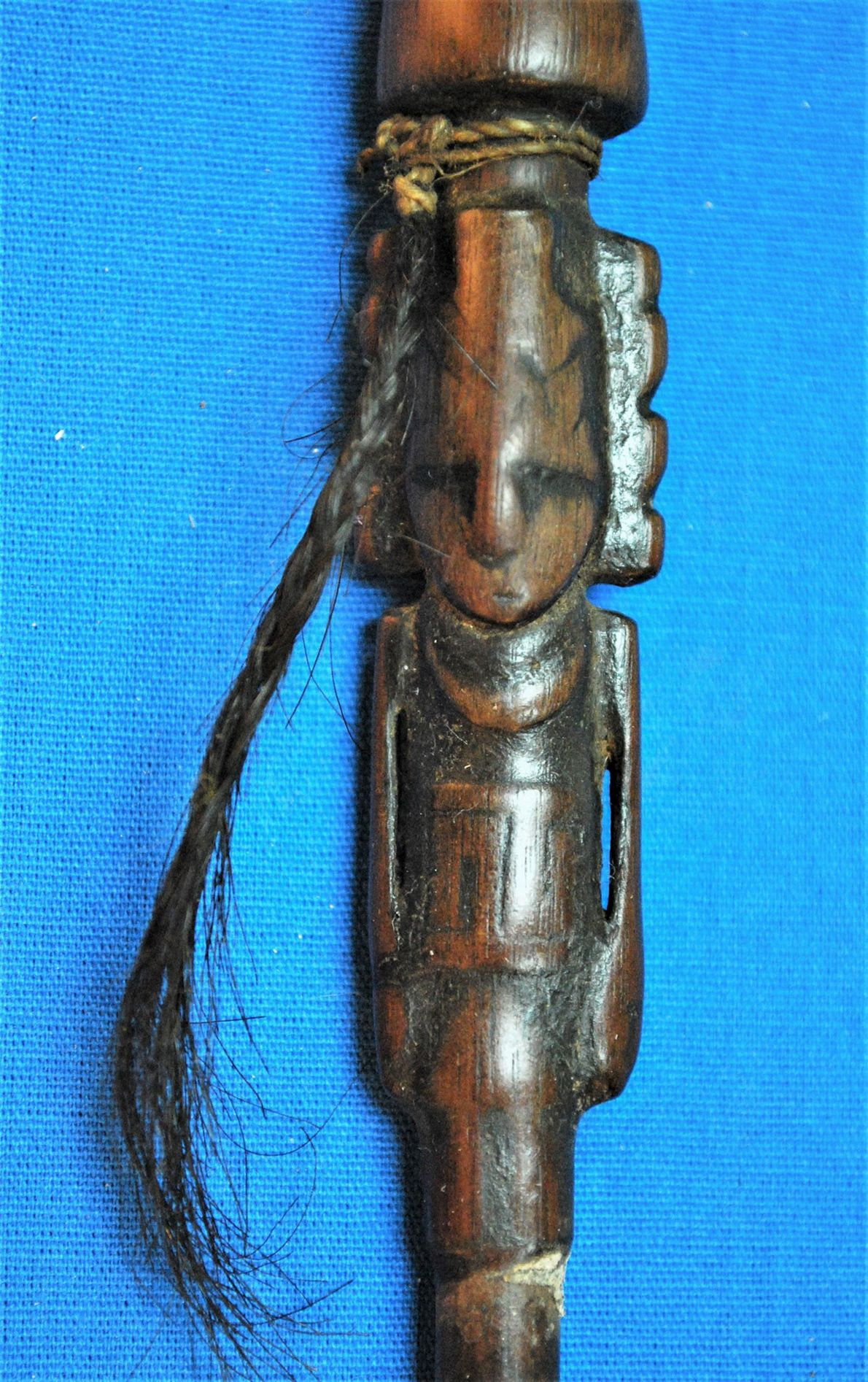 A snuffing tube found in the ritual bundle was carved in the form of a human-like ...