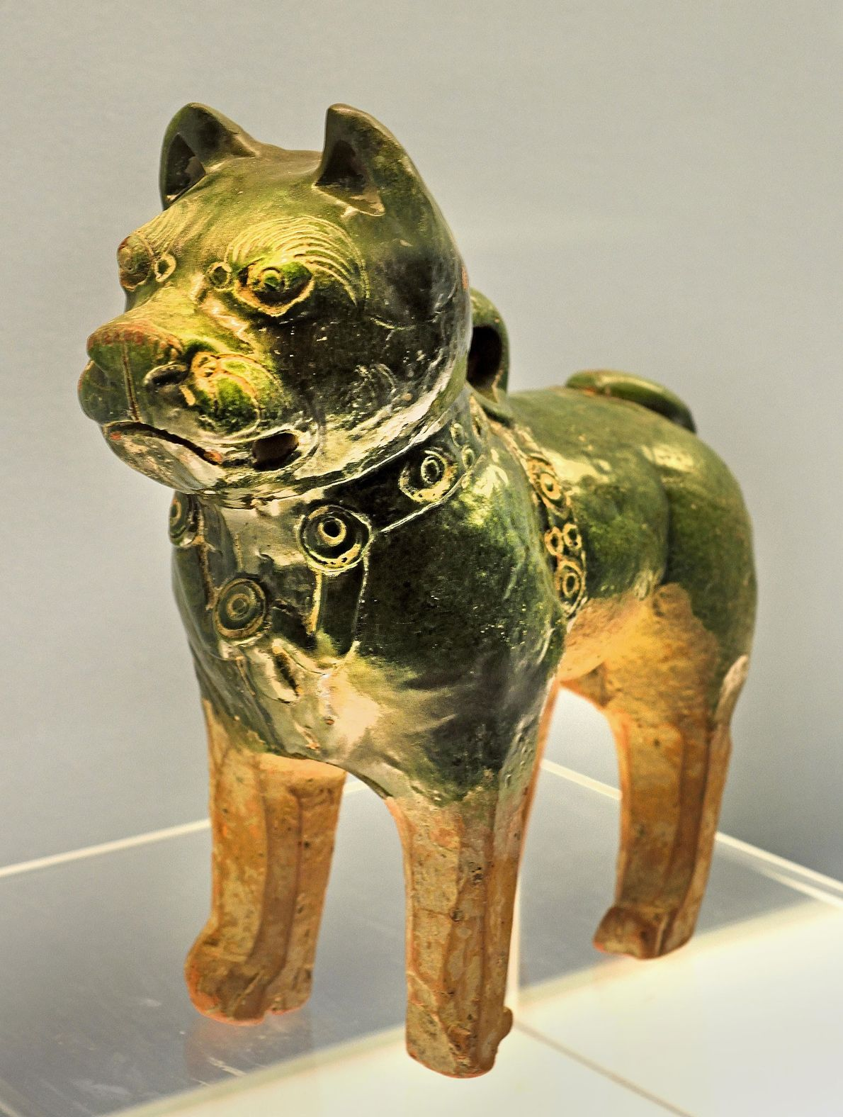 This glazed ceramic dog from the Eastern Han Dynasty (25 B.C. - 220 A.D.) may represent ...