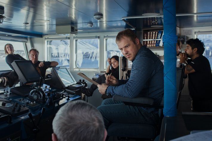 Captain Sergiy Demydov leads a briefing with the Arctic Sunrise crew.