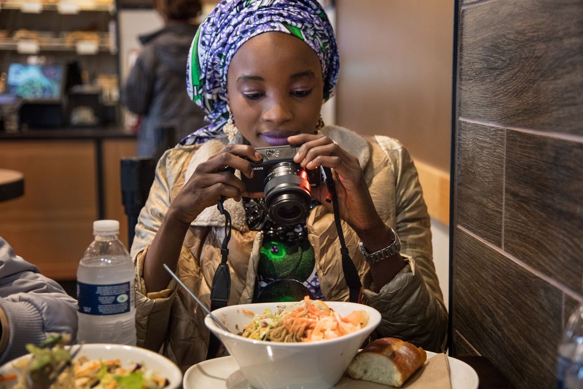 Ya Kaka, who was kidnapped at 15 years old, photographs her meal at Panera Bread. While ...