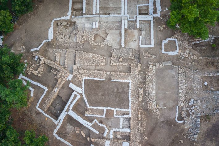 An aerial photo of the site shows a horizontal trench running through the upper half of ...