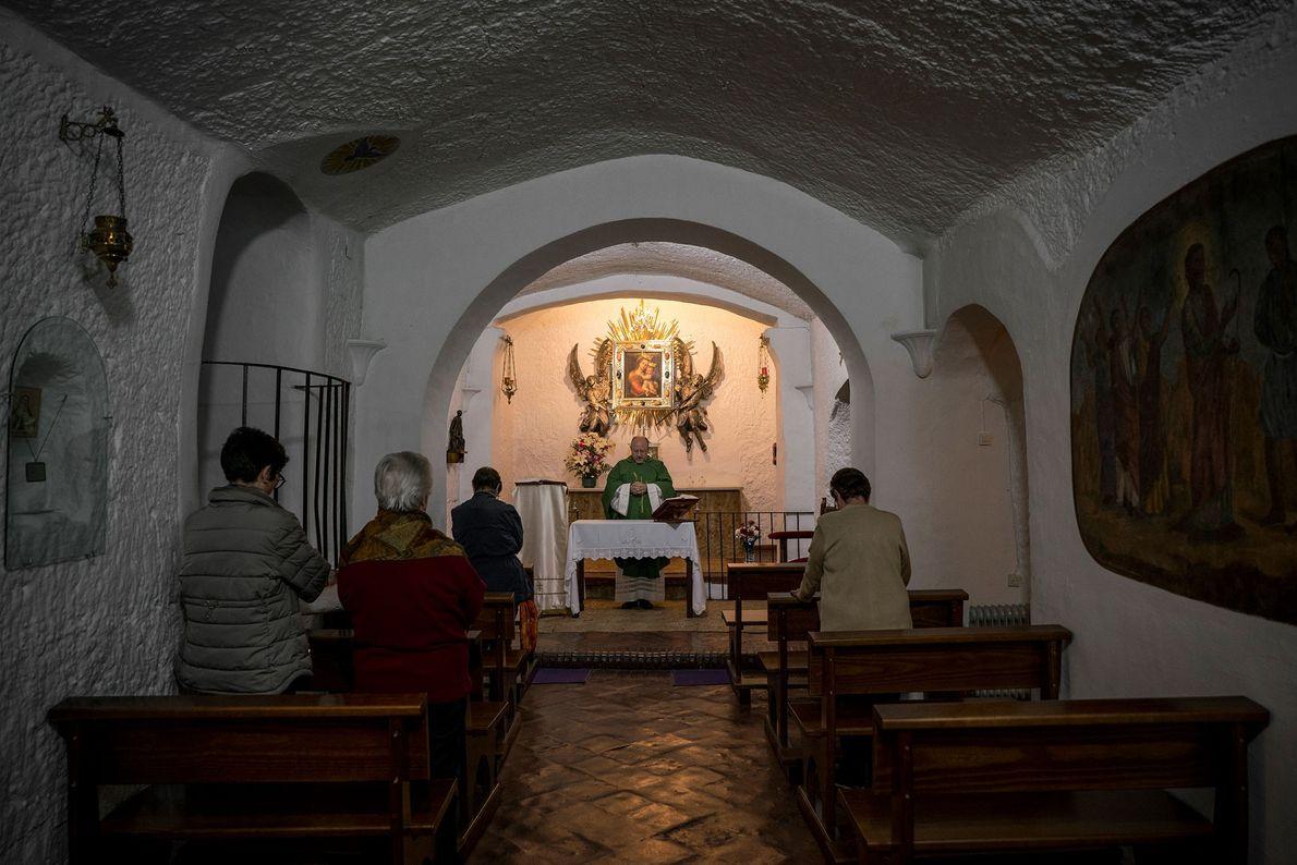 A priest leads a service in Nuestra Señora de Gracia, an underground Catholic Church in Guadix. ...