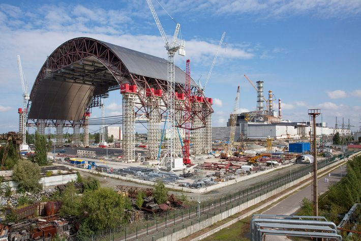 The massive containment arch will eventually be slid into place over the highly radioactive Unit 4 ...