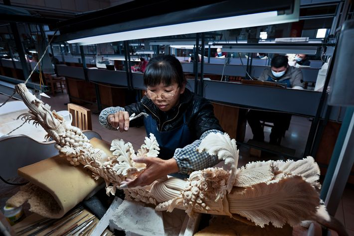 Before the ivory ban, China had many state-licensed ivory carving factories and retailers. This factory in ...