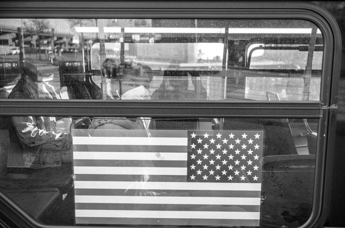 A commuter wearing a mask rides the bus through the Bronx. An estimated 75 percent of ...