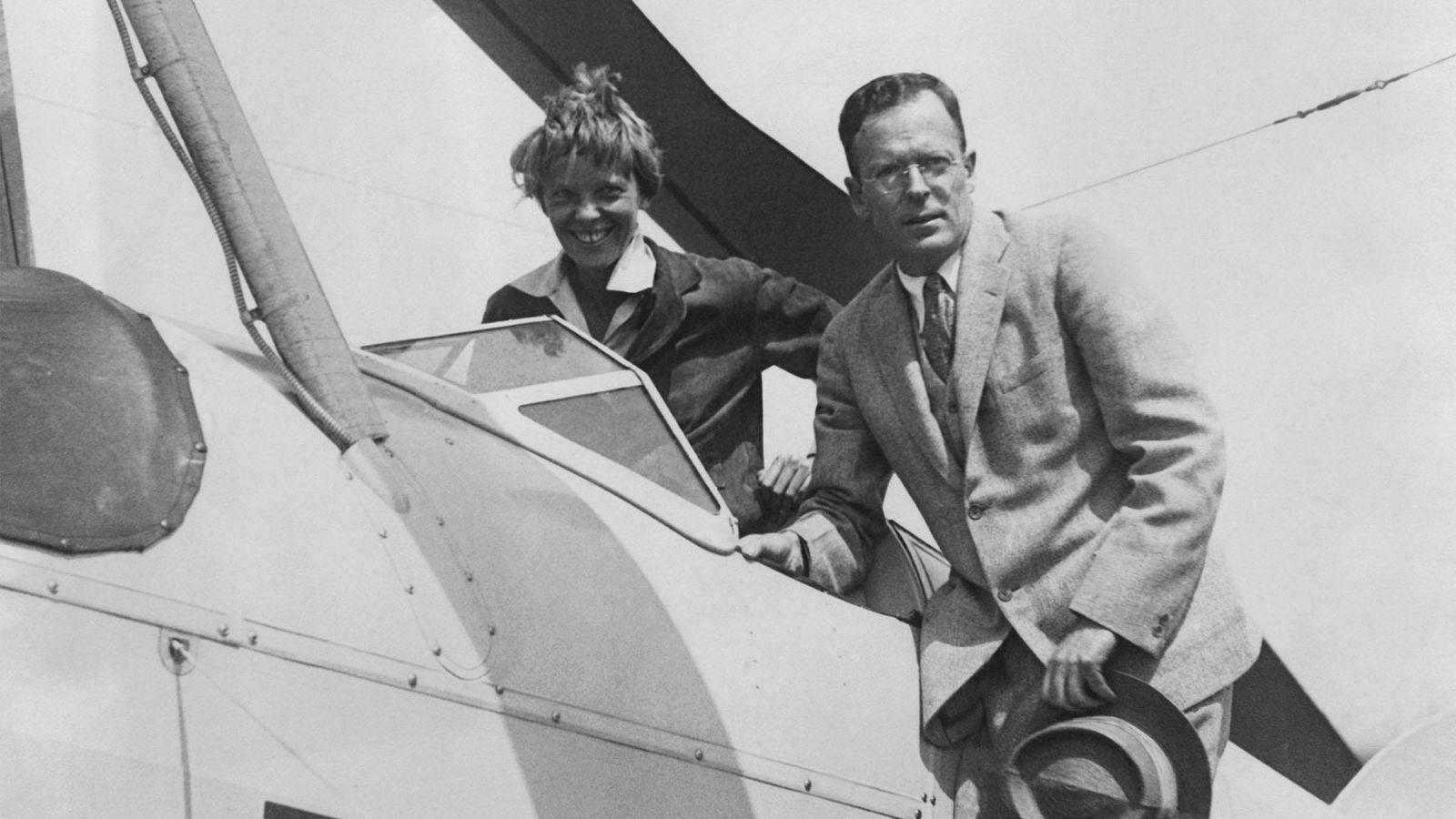 Amelia Earhart is greeted by her husband George Palmer Putnam on her return to Newark Airport, ...