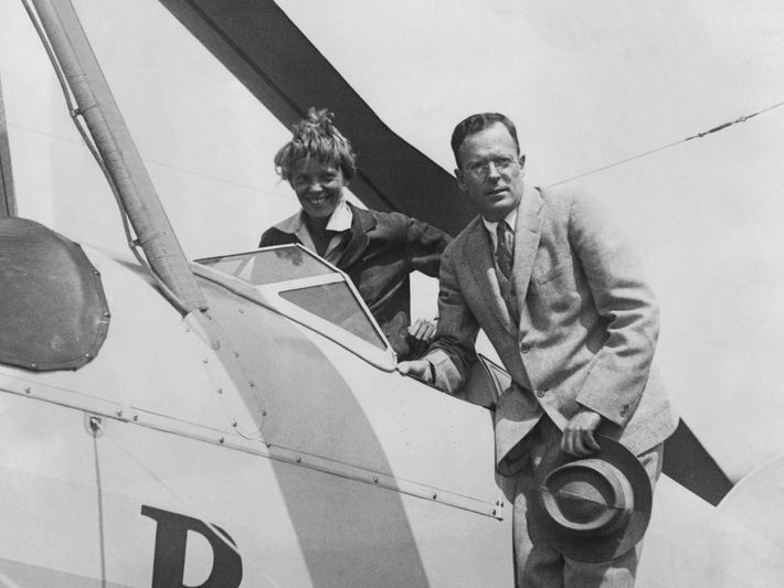 Amelia Earhart is greeted by her husband George Palmer Putnam on her return to Newark Airport, ...
