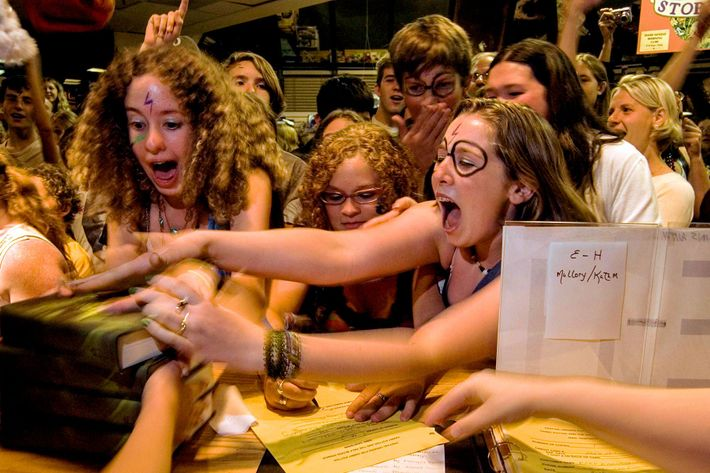 Customers rush to grab the sixth book in the Harry Potter series by J.K. Rowling, 'Harry ...