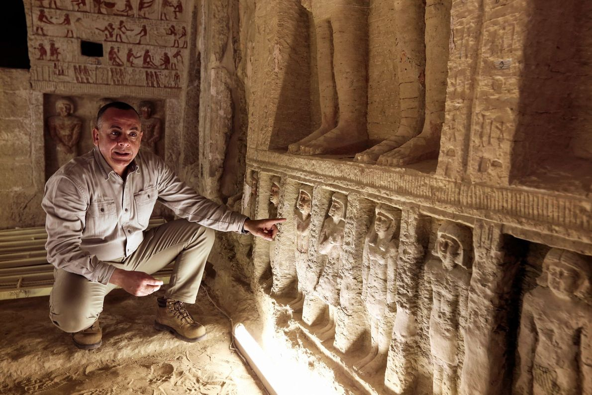 Mostafa Waziri, secretary general of the Supreme Council of Antiquities, shows off the small statues in ...