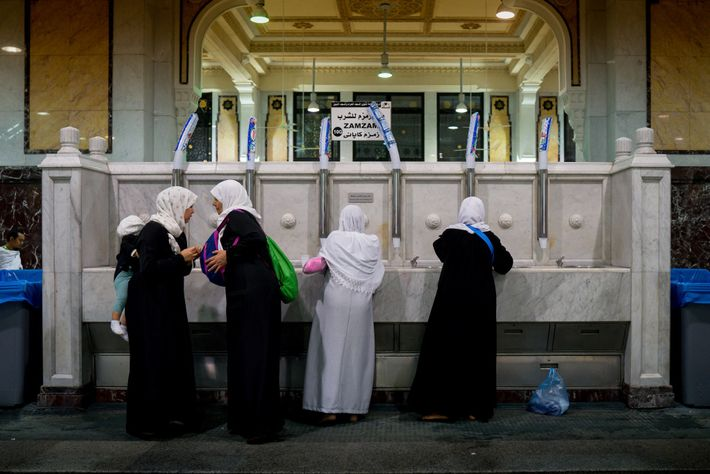 Women collect Zamzam water from a fountain in the Grand Mosque. The water is believed to ...
