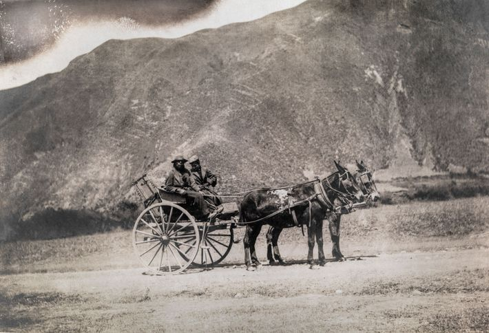 Harriet Chalmers Adams and her driver on the old Inca road to Cuzco, Peru. On her ...