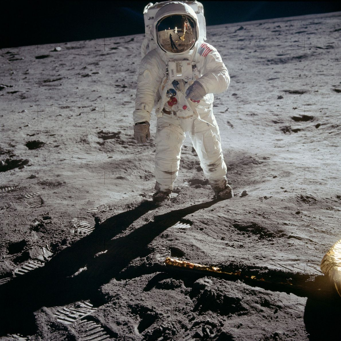 """Edwin """"Buzz"""" Aldrin stands on the lunar surface."""
