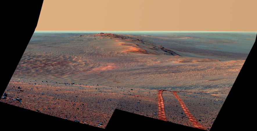 On August 15, 2014—the 3,754th Martian sol of Opportunity's mission—the rover looked back toward the western rim of Endeavor Crater, capturing its tire treads and unprecedented journey across the red planet's surface.
