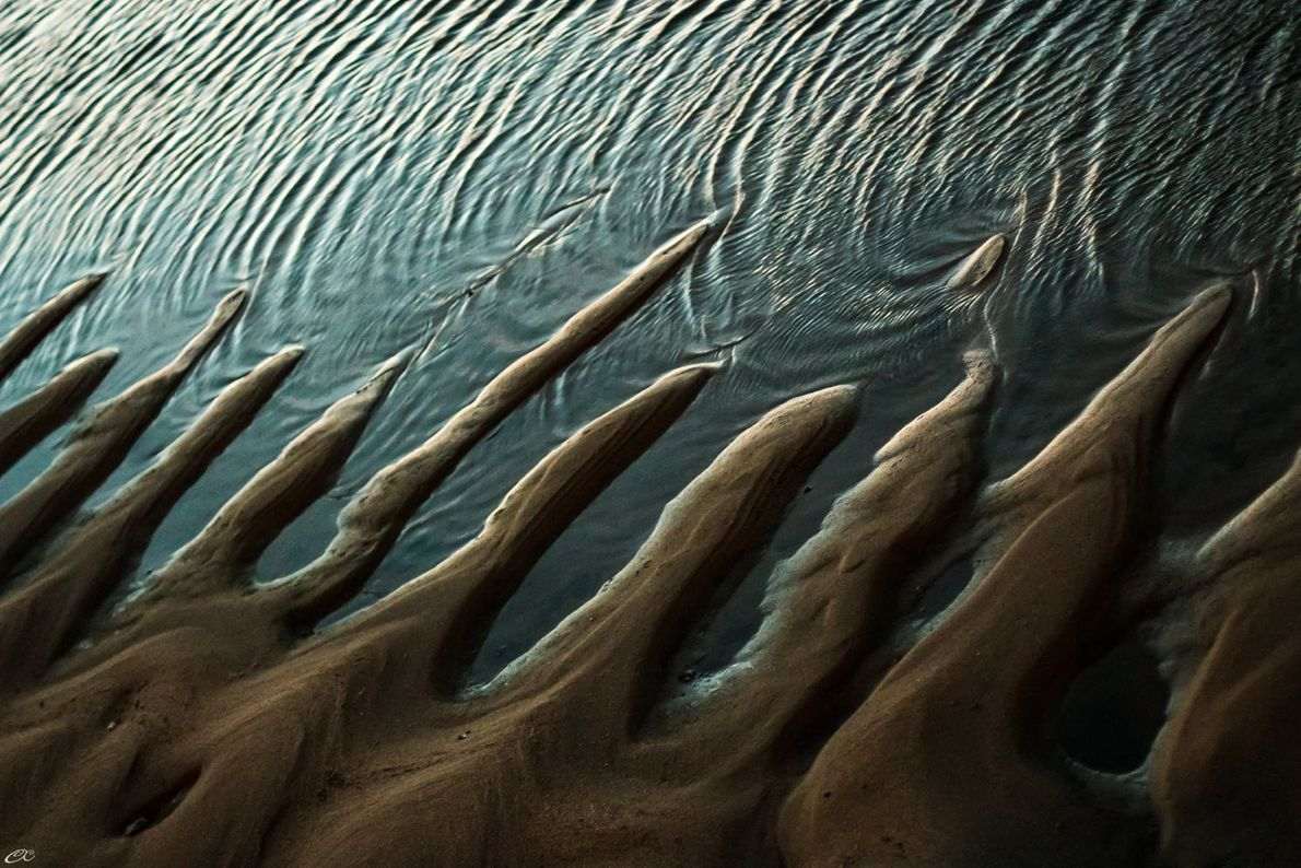 """""""When sand and water meet, they want to touch each other, as long as they can,"""" ..."""