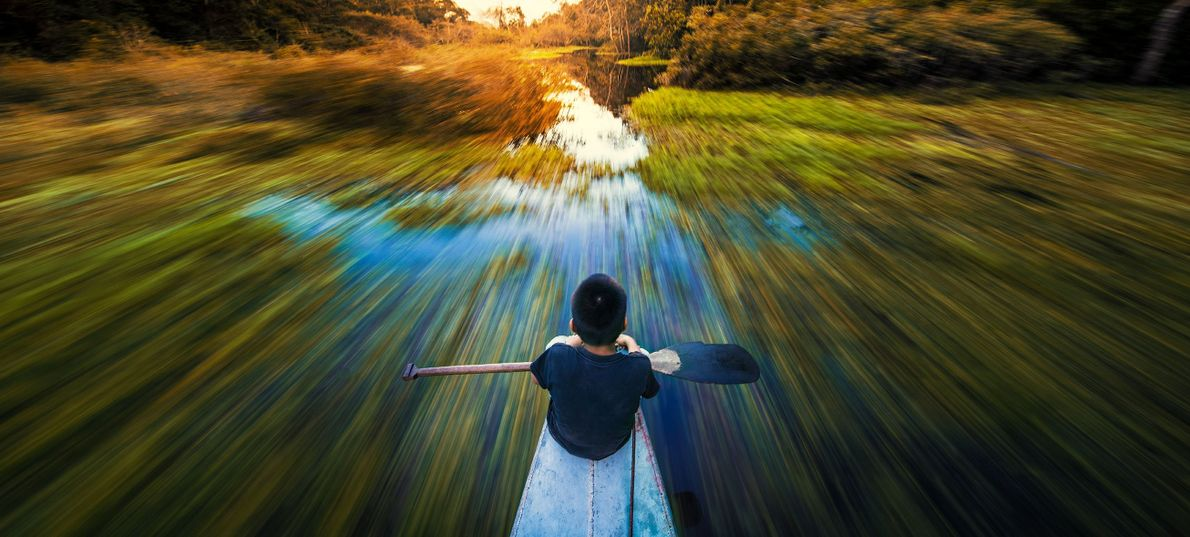 Your Shot photographer John Quintero made this photograph of a boy on a boat crossing the ...