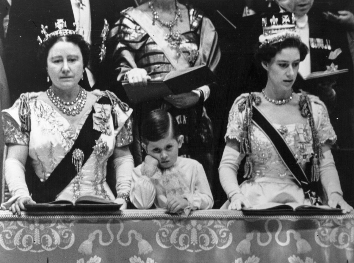 Prince Charles (centre) watches the coronation of his mother Queen Elizabeth II in the royal box ...