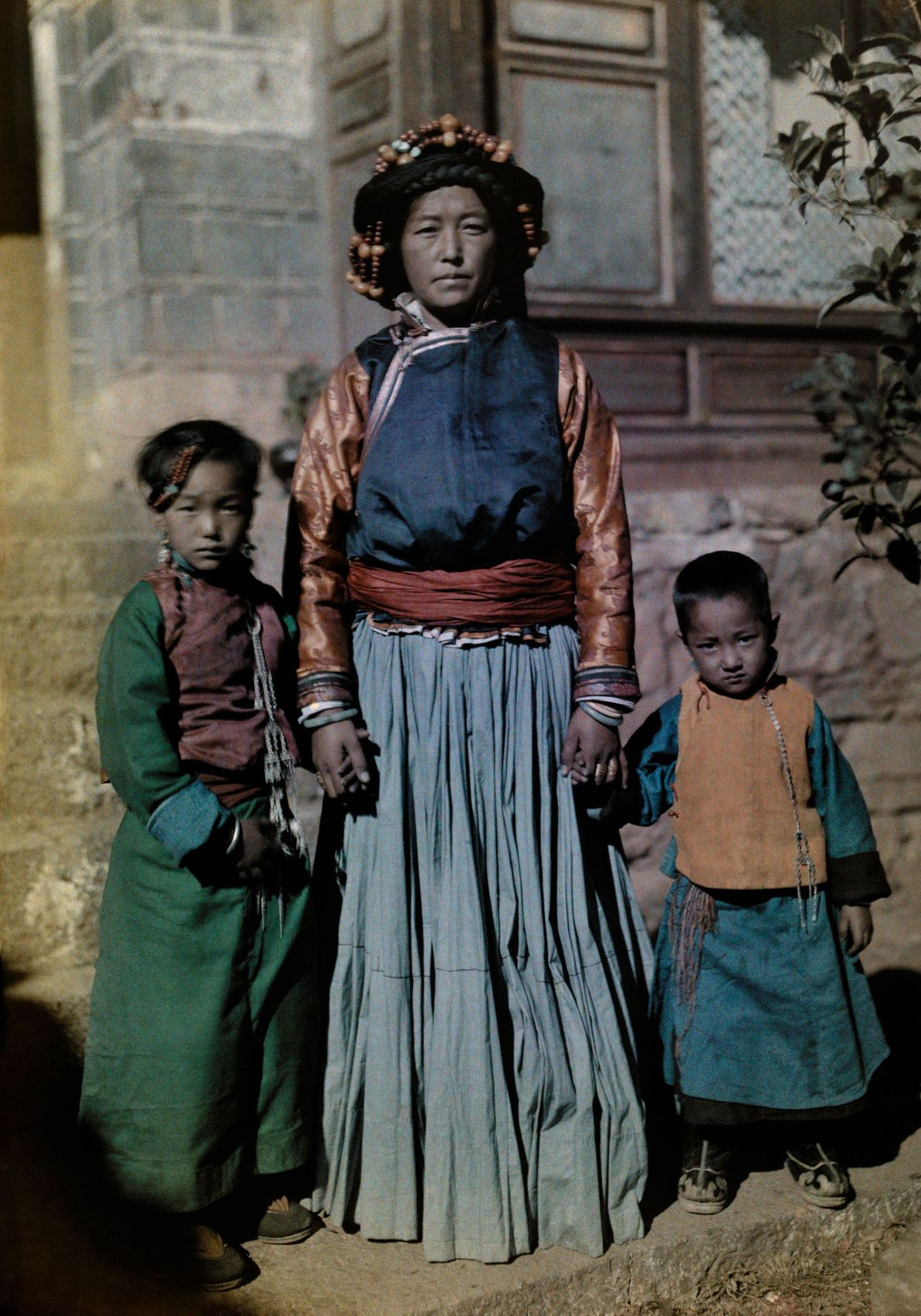 The Queen of Nyorophu, an island in the middle of Lugu Lake in China, is flanked ...