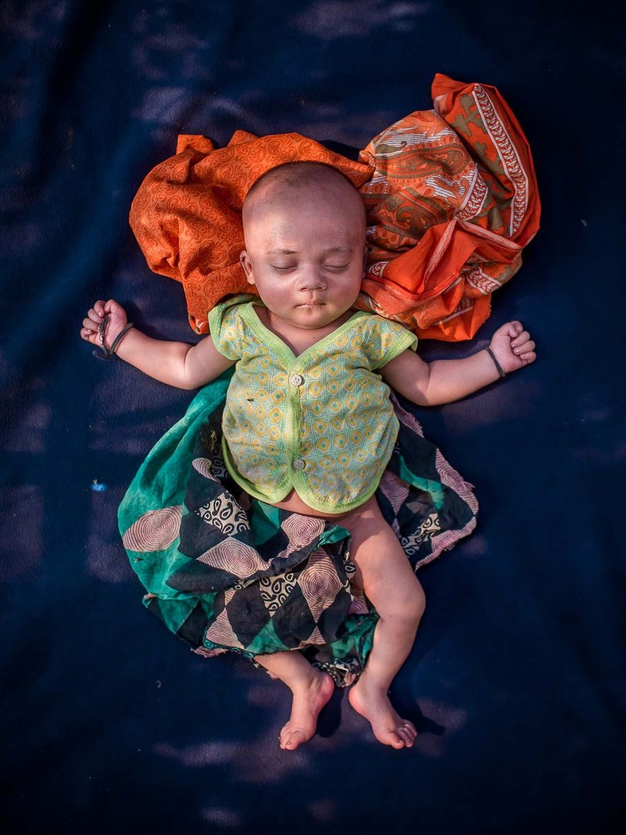 An unnamed 18-day-old baby, born in Cox's Bazar.