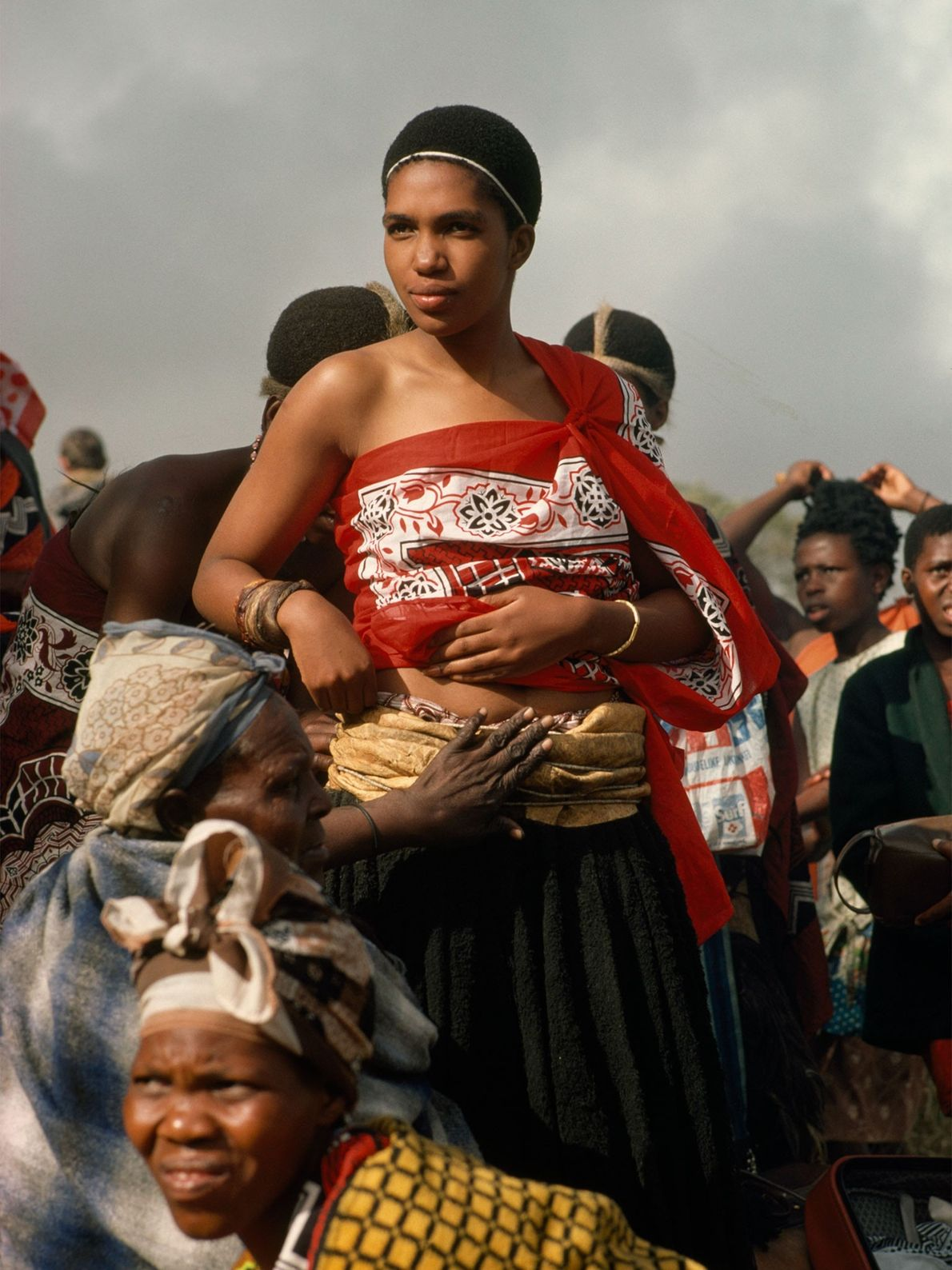 A Swazi princess is dressed by older women on her wedding day in the 1970s in ...